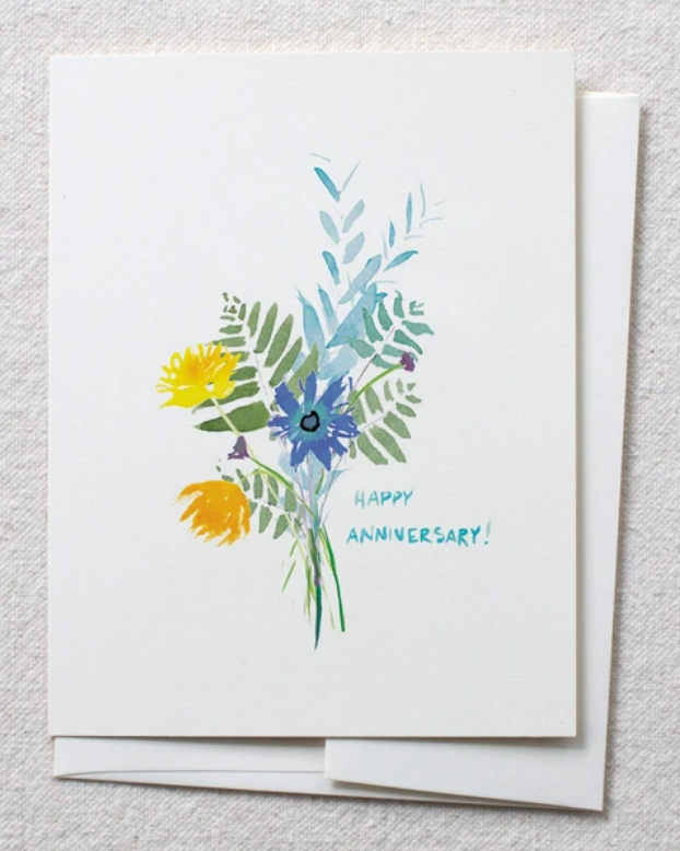 photo of card with watercolor flower and fern bouquet and text reading 'happy anniversary'