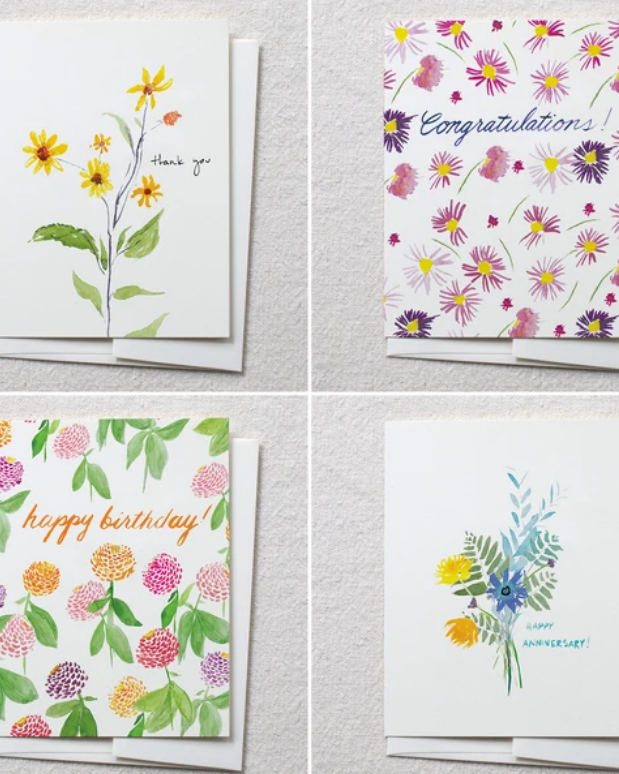 photo image of four cards that make a set with watercolor flowers and text reading 'happy birthday' 'thank you' 'congratulations' and 'happy anniversary's