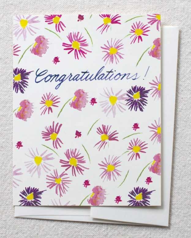 photo of card with watercolor purple aster and text reading 'congratulations'
