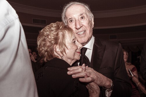 photo of senior couple slow dancing and smiling