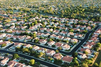 aerial shot of suburban homes and trees