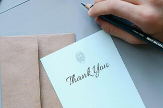 wedding thank you note on top of brown envelope