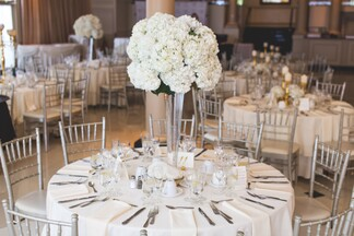 wedding reception tables with flower decor