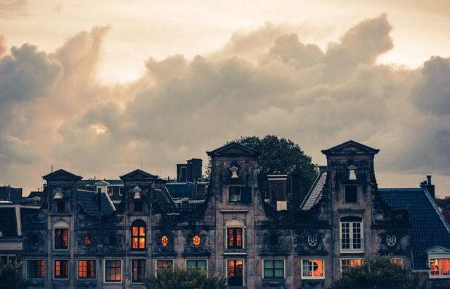photo: old house with orange light coming out all the windows