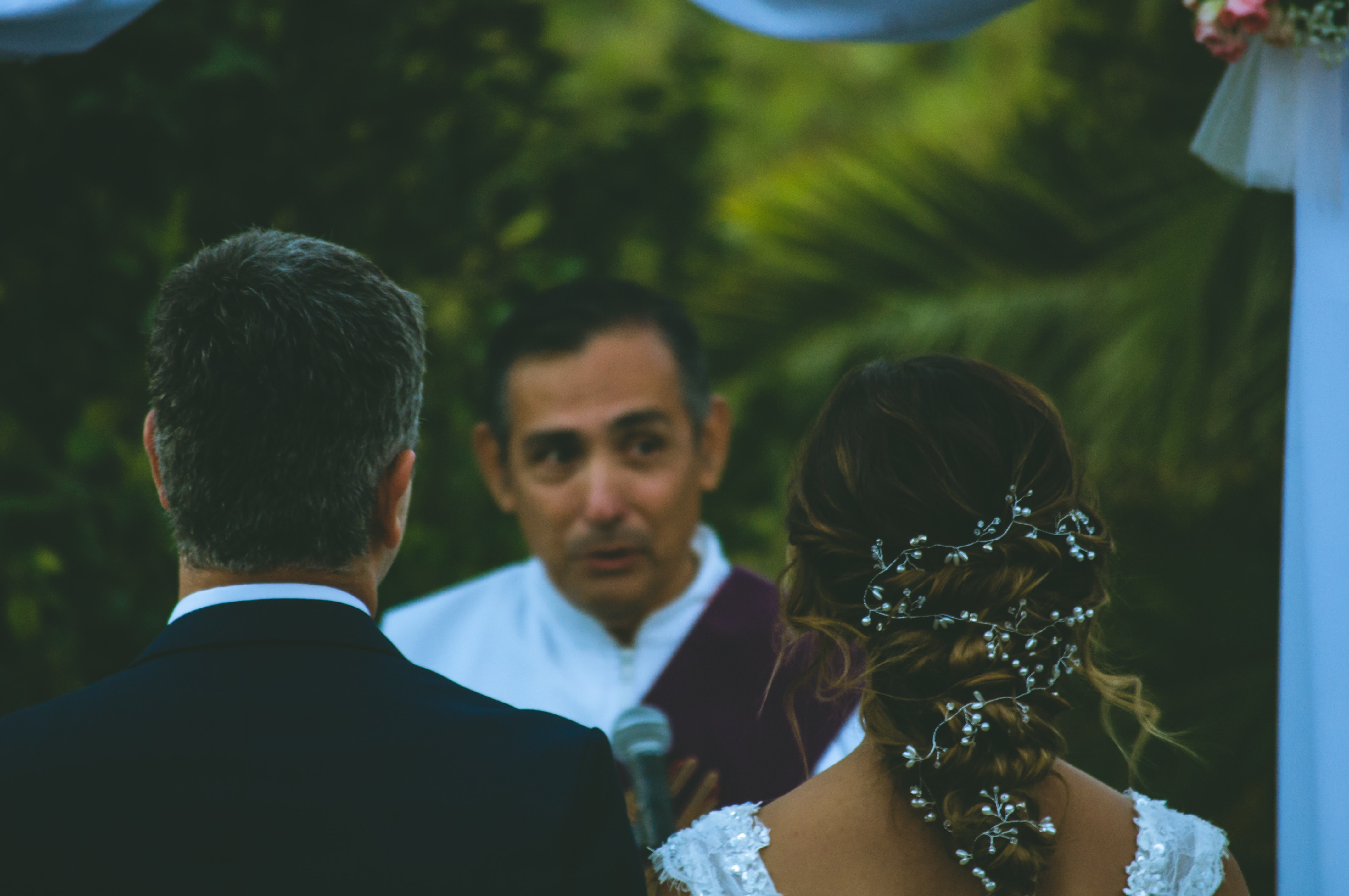 wedding officiant at the alter with the bride and groom